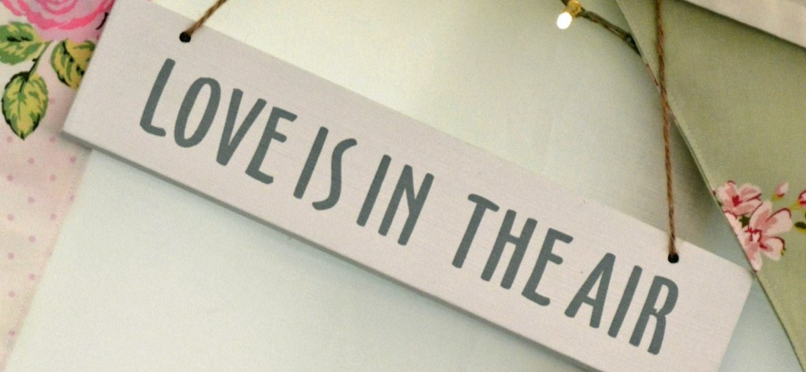 Love is in the air wedding sign